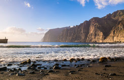 Amazing view of beach in Los Gigantes, Tenerife, Canary Islands. Amazing view of beach in Los Gigantes with high cliffs on the sunset. Location: Los Gigantes Stock Image