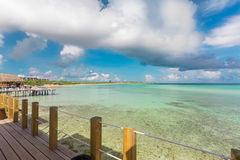 Amazing view from the beach pier deck on tranquil ocean and cloudy blue sky background Stock Photo