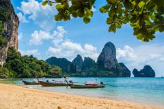Amazing view of beautiful Ao Nang Beach with longtale boats. Loc Stock Photos