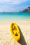 Amazing view of beautiful beach with kayak on the sand. Location Stock Image