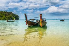 Amazing view of beautiful beach with longtale boats. Location: K Stock Images