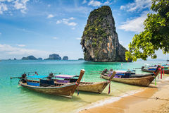 Amazing view of beautiful beach with longtale boats. Location: R Royalty Free Stock Image