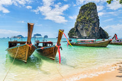 Amazing view of beautiful beach with longtale boats. Location: R Stock Images