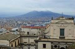 Looking across from Castel Sant Elmo to vesuvius. Amazing view of the beautiful city of naples napoli from the castel sant elmo. roofs coloured buildings stock photography