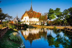 Amazing view of beautiful Dusit Maha Prasat Palace The Grand Pa. Lace with reflection in the water. Location: Ancient City Park, Muang Boran, Samut Prakan Stock Photography