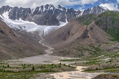 Glacier mountains river trees summer Stock Images