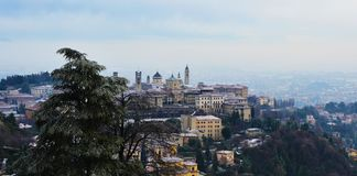 Amazing view of Bergamo city with snow on the old upper city, Italy Stock Images