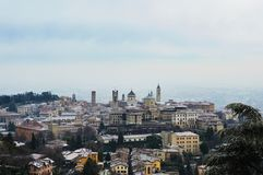 Amazing view of Bergamo city with snow on the old upper city, Italy Royalty Free Stock Photo