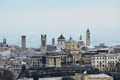 Amazing view of Bergamo city with snow on the old upper city, Italy Stock Photos