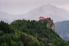 Amazing view on Bled lake, Bled castle at sunrise with mountain Triglav in background. Slovenia, Europe Stock Photo