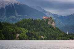 Amazing view on Bled lake, Bled castle at sunrise with mountain Triglav in background. Slovenia, Europe Royalty Free Stock Image