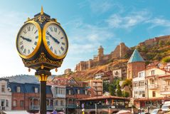 City clock and Narikala fortress, Tbilisi, Georgia. Amazing view of City clock, Old Meidan Square and Narikala ancient fortress in the sunny morning, Tbilisi royalty free stock photography