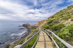Amazing view of the coastline from beachside boardwalk. Boardwalk down to sea shore giving a beautiful view of the coastline and the sea Stock Image
