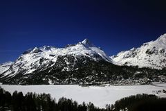 Amazing view and color of a snowy mountain in the alps switzerland.  Stock Photo