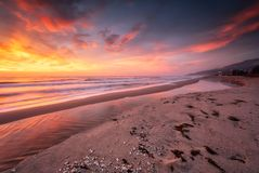 On the seashore at sunrise stock image
