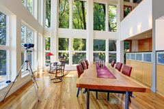 Amazing view of dining room in modern lake house. Royalty Free Stock Image