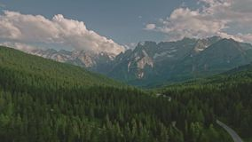 Amazing view from drone of mountain forests and fields in Dolomites Alps stock video footage