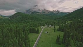 Amazing view from drone of mountain forests and fields in Dolomites Alps stock footage