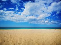 Amazing view of the emerald sea, yellow sand and blue sky with clouds, spring. Spain royalty free stock images