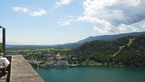 Amazing view from fancy restaurant terrace at lakeside town and high mountains. Stock footage stock footage