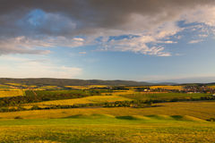 Amazing view from golf course to the valley. At sunset Royalty Free Stock Image
