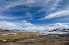 Amazing view of high altitude Tibetan plateau and cloudy sky Royalty Free Stock Image