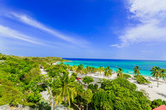 Amazing view of Holguin province tropical inviting beach and tranquil azure turquoise ocean on blue sky background Stock Image