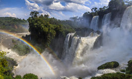 Amazing view of the Iguassu Falls and rainbow. Argentina Royalty Free Stock Images