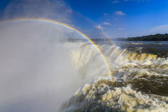 Amazing view of the Iguassu Falls and rainbow. Royalty Free Stock Images