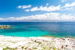Blue lagoon in Kassiopi in Corfu island, Greece. Amazing view on ionian sea from Corfu island in Greece Royalty Free Stock Photos