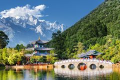 Amazing view of the Jade Dragon Snow Mountain, Lijiang, China. Amazing view of the Jade Dragon Snow Mountain and the Black Dragon Pool, Lijiang, Yunnan province royalty free stock image