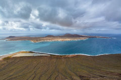 Amazing view on La Graciosa island from Mirador del Rio on a cloudy day, Lanzarote, Spain Stock Photo