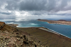 Amazing view on La Graciosa island from Mirador del Rio on a cloudy day, Lanzarote, Spain royalty free stock photo