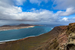 Amazing view on La Graciosa island from Mirador del Rio on a cloudy day, Lanzarote, Spain royalty free stock images