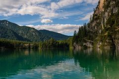 Amazing view of Lago di Braies with mountain forest on the background. Stock Images