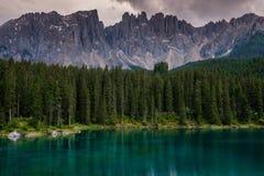 Amazing view of Lago di Carezza with wild mountain forest, Trentino-Alto Adige, Italia. Stock Images