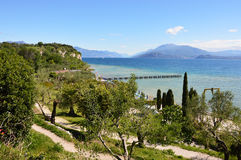 Amazing view of Lake Garda from the hills of the park Parco Pubblico Tomelleri in Sirmione town, Italy Royalty Free Stock Photography