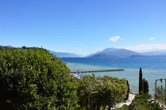 Amazing view of Lake Garda from the hills of the park Parco Pubblico Tomelleri in Sirmione town, Italy Stock Photo