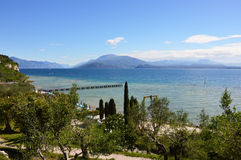 Amazing view of Lake Garda from the hills of the park Parco Pubblico Tomelleri in Sirmione town, Italy Royalty Free Stock Photo