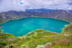 Amazing view of lake of the Quilotoa caldera. Quilotoa is the western volcano in Andes range and is located in andean Stock Photography