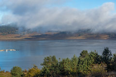 Amazing view of Low clouds over water of Batak Reservoir, Bulgaria Stock Image