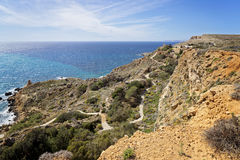 Amazing view of Malta`s sea coast, sea and cliff. Panoramic view of amazing Maltese sea coast, sea and cliff Stock Image
