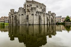 Amazing view of the medieval castle the Gravensteen Castle of the Counts surrounded by water stock images