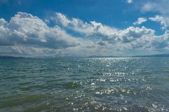 Amazing view of the mountain lake Son-Kul. With beautiful clouds and blue sky Stock Photo
