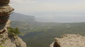 Amazing view mountain peak on sea shore on horizon. Scenic landscape from high mountain to modern city on sea shore and stock video footage