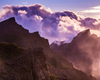 Amazing view of mountain peaks with beautiful clouds on the suns Royalty Free Stock Images