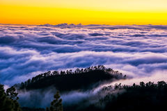 Amazing view of mountain peaks with beautiful clouds on the suns. Et. Location: Tenerife, Canary Islands, Spain. Artistic picture. Beauty world Stock Photo