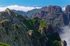 Amazing view on the mountain peaks from Pico do Arieiro on Madeira island. Amazing view on the mountain peaks from Pico do Arieiro on Portuguese island of royalty free stock images