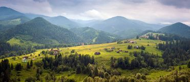 Amazing view of the mountain village Dzembronya foggy morning in the mountains in summer. royalty free stock photography