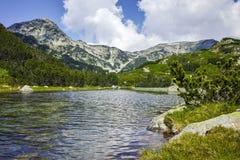 Amazing view of Muratov peak and river in Pirin Mountain Stock Photo